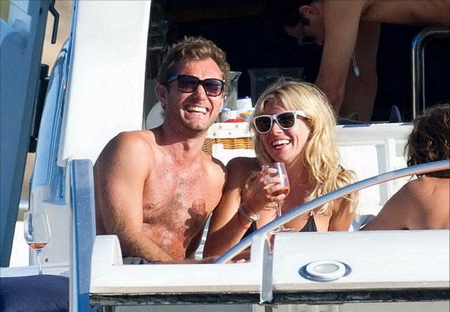 Jude Law, black swim boots, sunglasses, Sienna Miller, black string bikini, sunglasses, wine glass