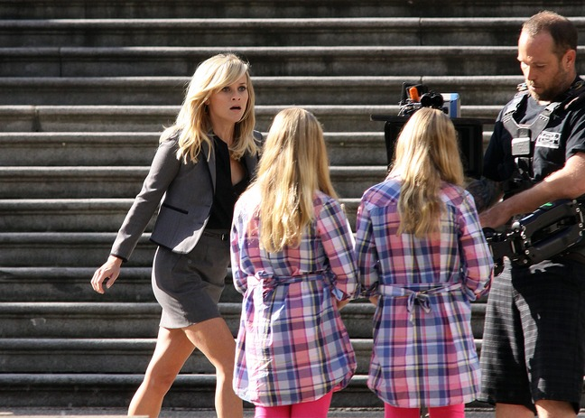 Reese Witherspoon, grey suit, high heels, black blouse, This Means War film set