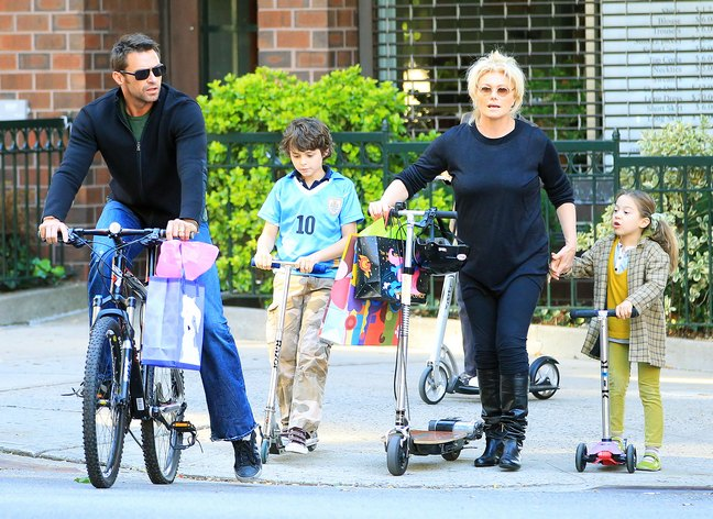 Hugh Jackman, jeans, black sweater, sunglasses, bike, Deborra-Lee Furness