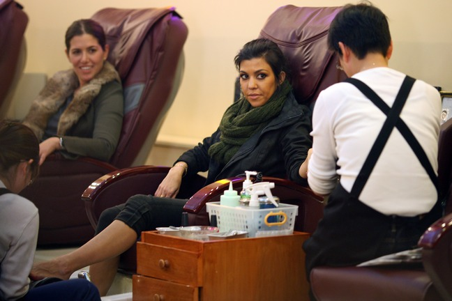 Kourtney Kardashian, black pants, green scarf, pedicure