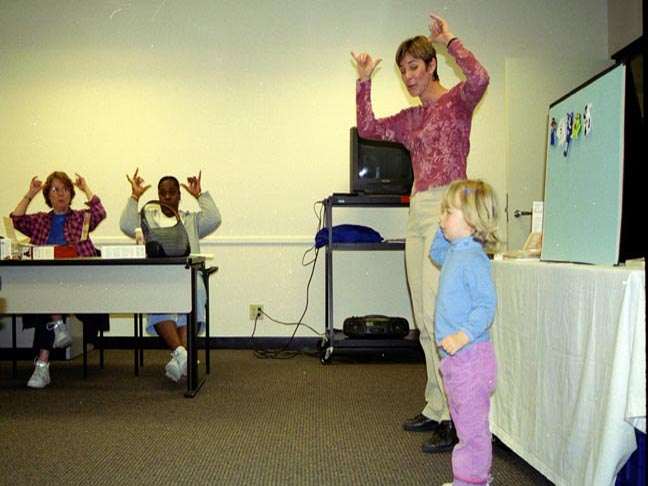 Monta Briant and her child teaching a class to sign language
