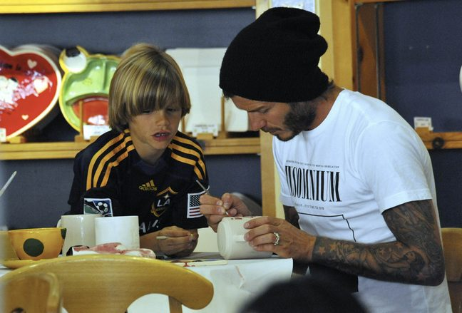 David Beckham, black knit hat, White shirt