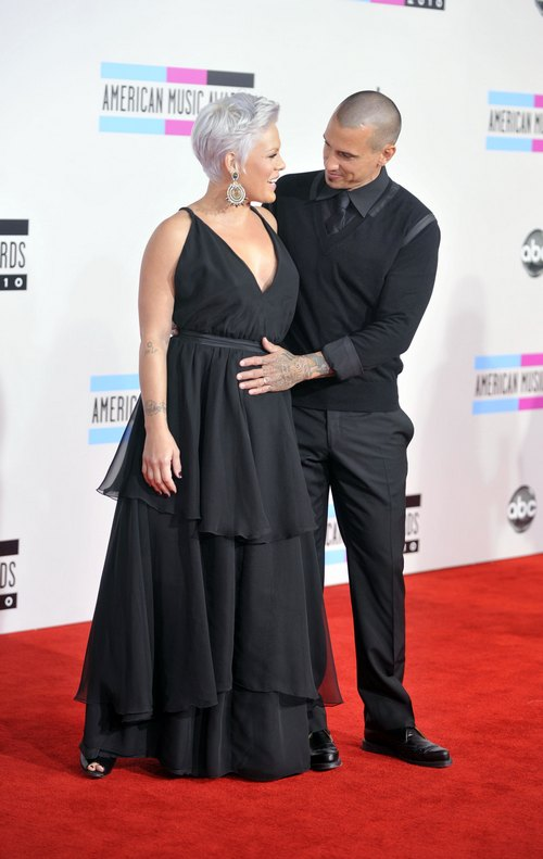 Pink, sleeveless black dress, CArey Hart, black suit