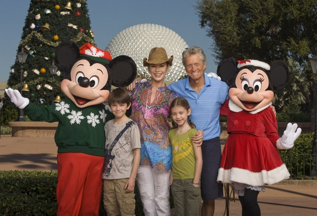 Michael Douglas, Catherine Zeta-Jones with Mickey Mouse and their children