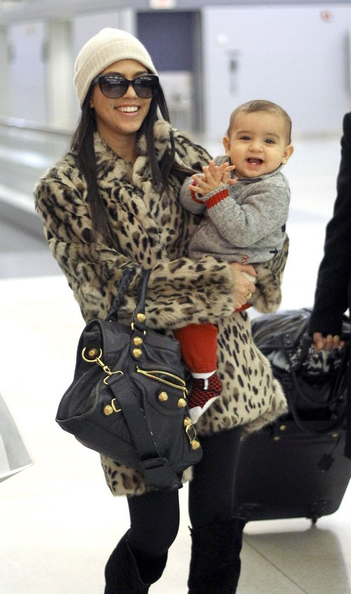 Kourtney Kardashian, leopard print coat, tan hat, black purse, sunglasses, black boots