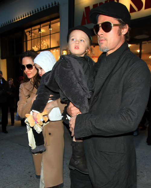 Angelina Jolie, tan trenchcoat, sunglasses, Brad Pitt, sunglasses,
