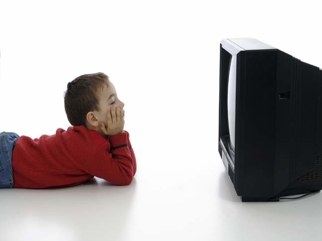 BOY IN FRONT OF TV