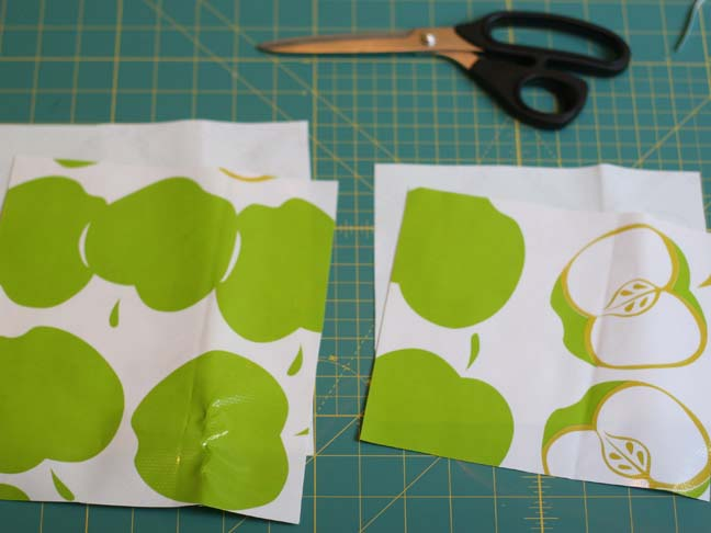 green apple oilcloth cut in half