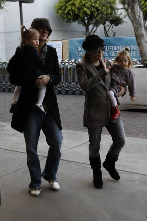 Lisa marie presley, plaid jacket, black hat, sunglasses, twin daughters, black boots