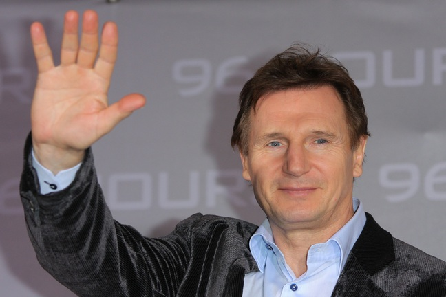 Liam Neeson, blue shirt, gray jacket