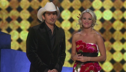 Carrie Underwood floral dress, Brad Paisley, black jacket, white cowboy hat