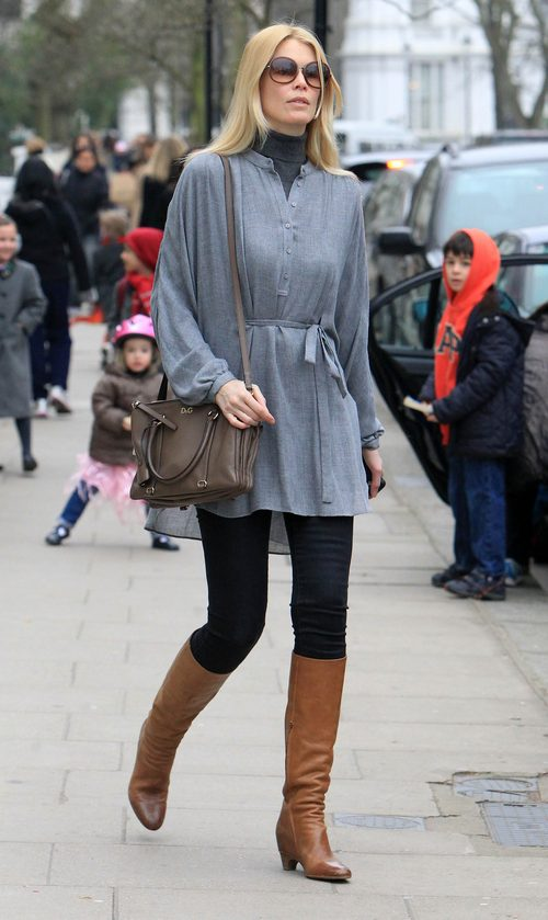 Claudia Schiffer, gray sweater, black leggings, boots