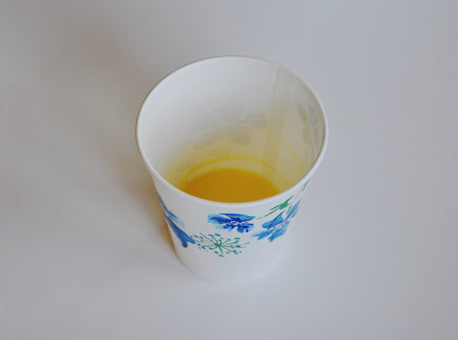 melted butter in paper cup