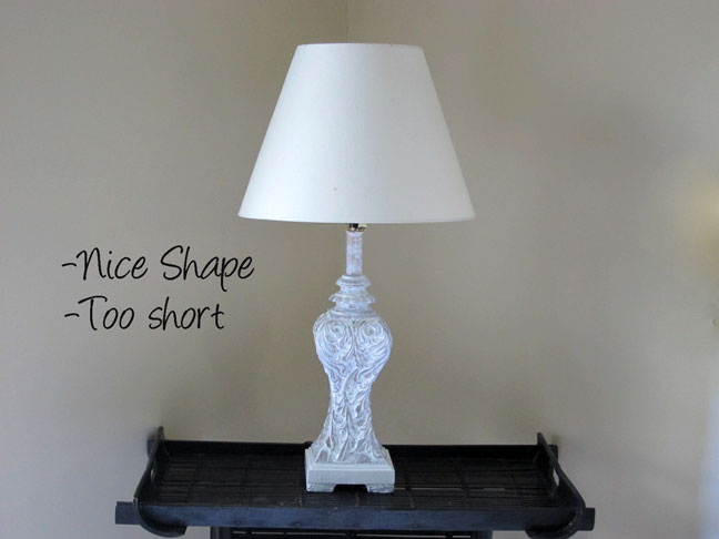 1 this is a classic white paper shade it casts a white light it has a nice a nice shape for this lamp but is too short