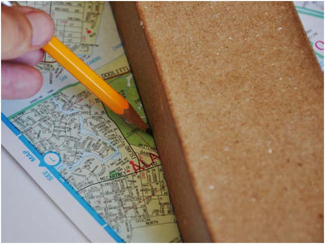 pencil tracing large letter on map