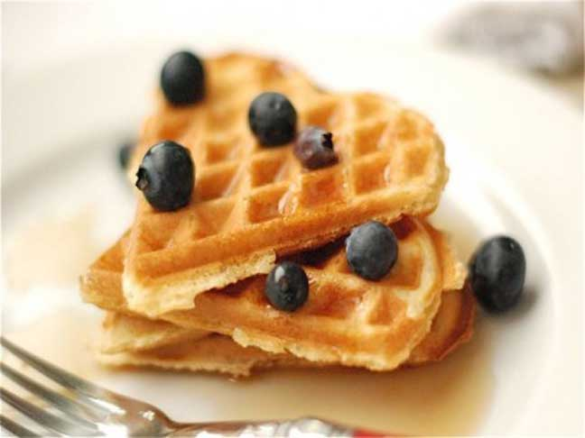 Cinnamon waffles with fresh blueberries on top