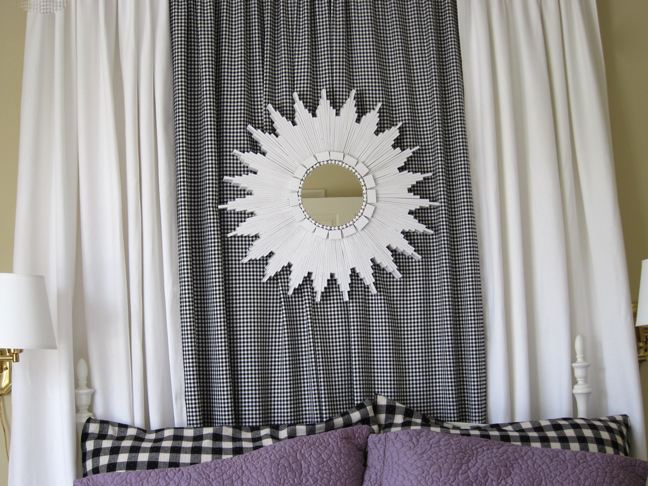 white starburst mirror over bed