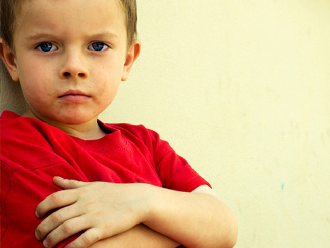 Boy red shirt crossed arms