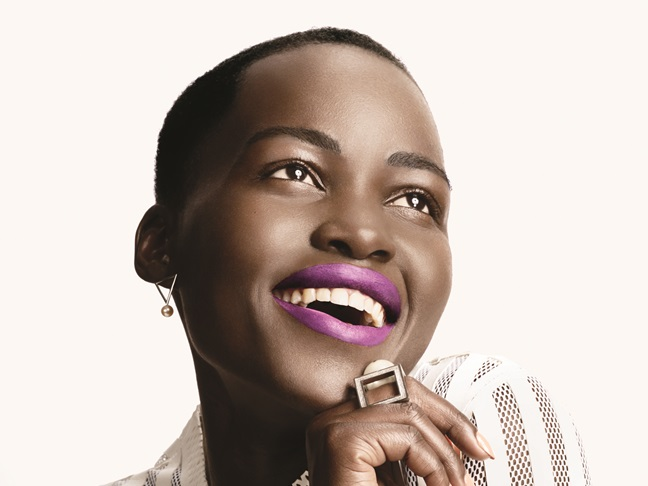 a washed out photo of Lupita Nyong'o with vibrant purple lipstick