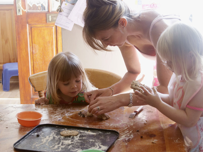 mother-baking-daughters-flour