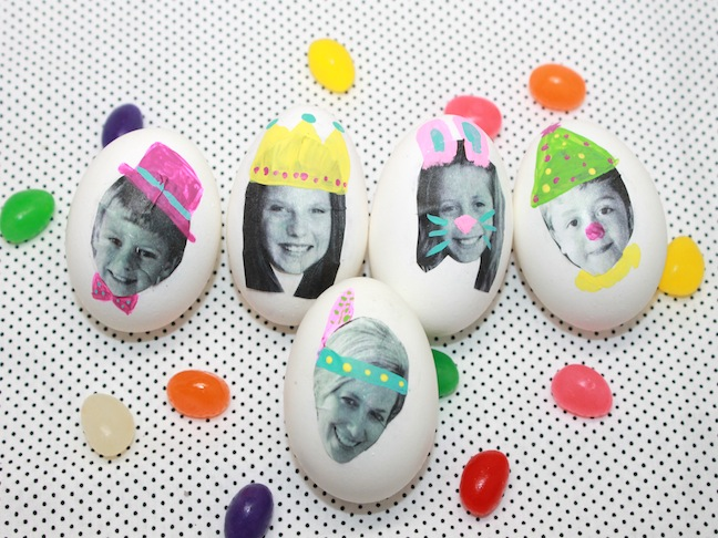 kids faces on easter eggs with jelly beans