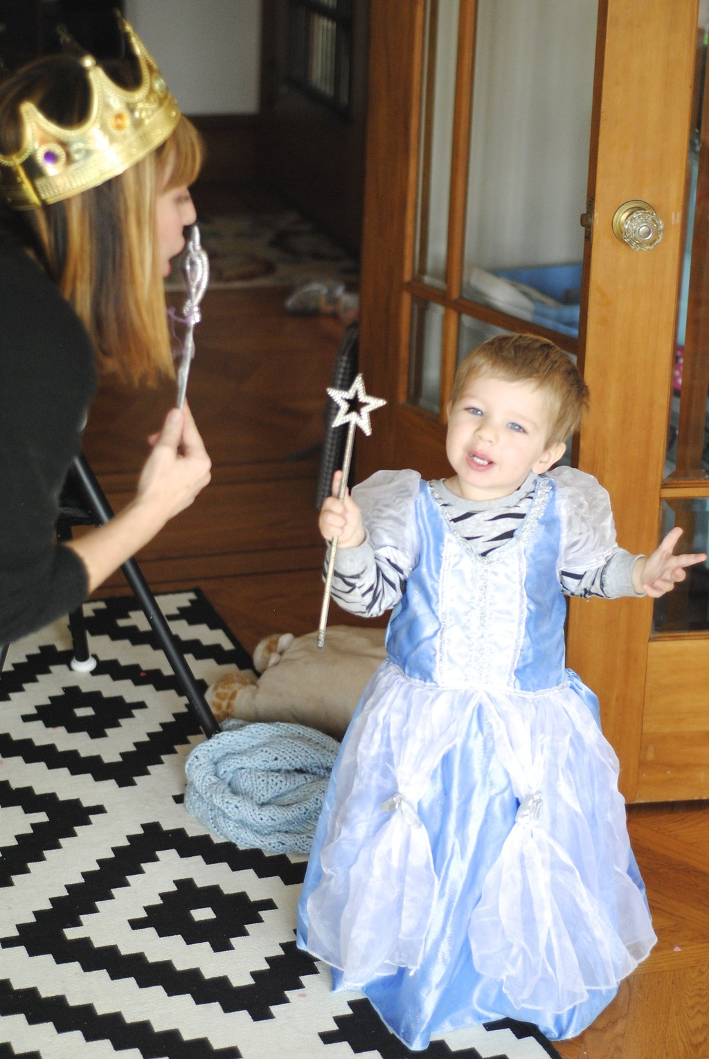little boy dressed up as princess and dancing