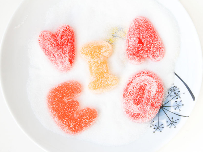 gummy-bear-letters-covered-in-sugar-on-plate