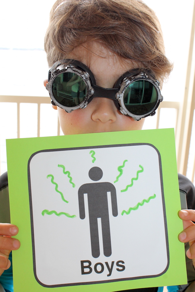 smelly boy bathroom sign with boy with goggles on