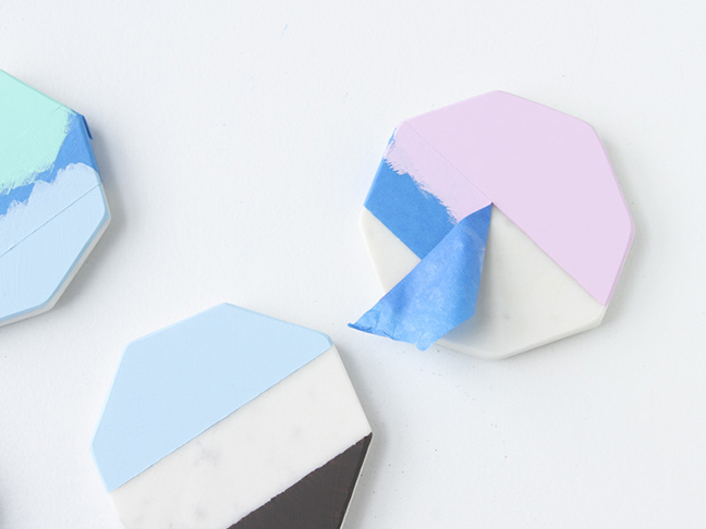 Remove tape from paint coasters.