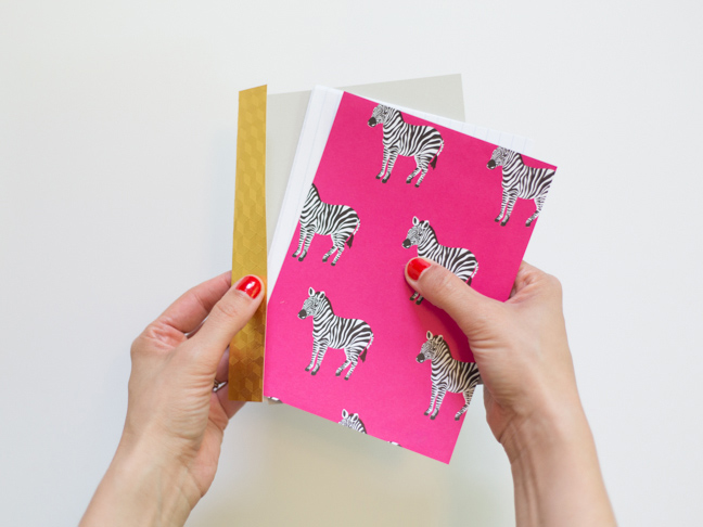 pink-zebra-paper-stacked-paper-gold-binding