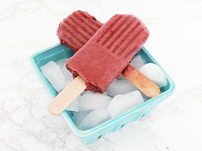 berry popsicles on ice