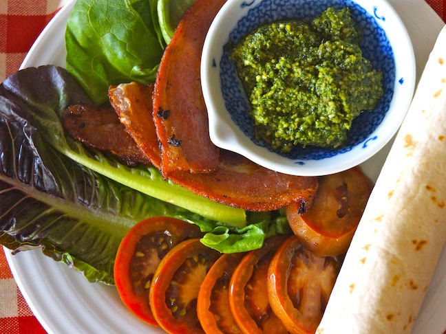 tortilla-lettuce-bacon strips-pesto-white plate-