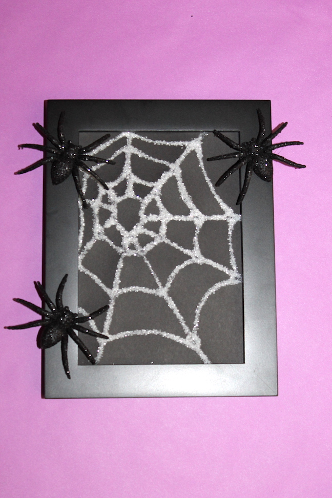 Frame final spider web photo frame with glitter spiders on it