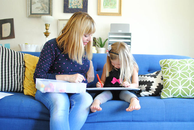 mom and daughter drawing on couch