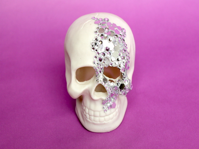skull with rhinestones and sequins on it