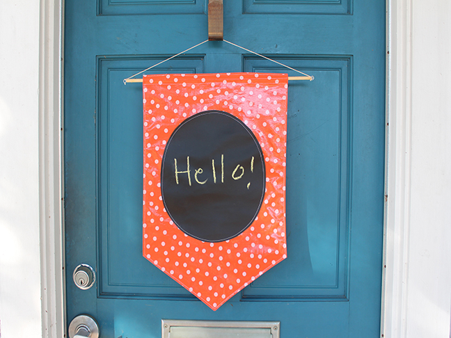 Sew this one of a kind fabric sign for your front door. Chalkboard fabric is just like regular chalkboard\u2014easy to sew with and super fun! & DIY: Chalkboard Fabric Door Sign