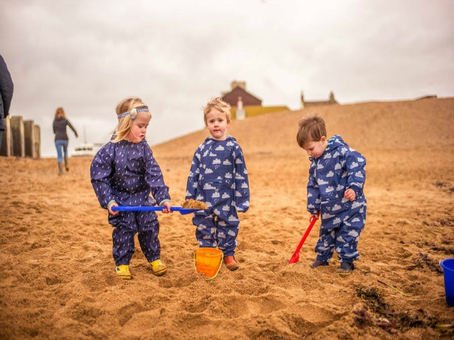 children_beach_puddle-pac-an-all-in-one-navy-raindrops (1)