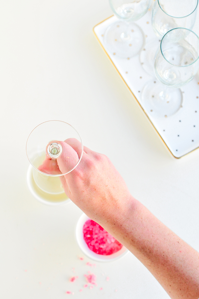 dipping champagne flute in simple syrup