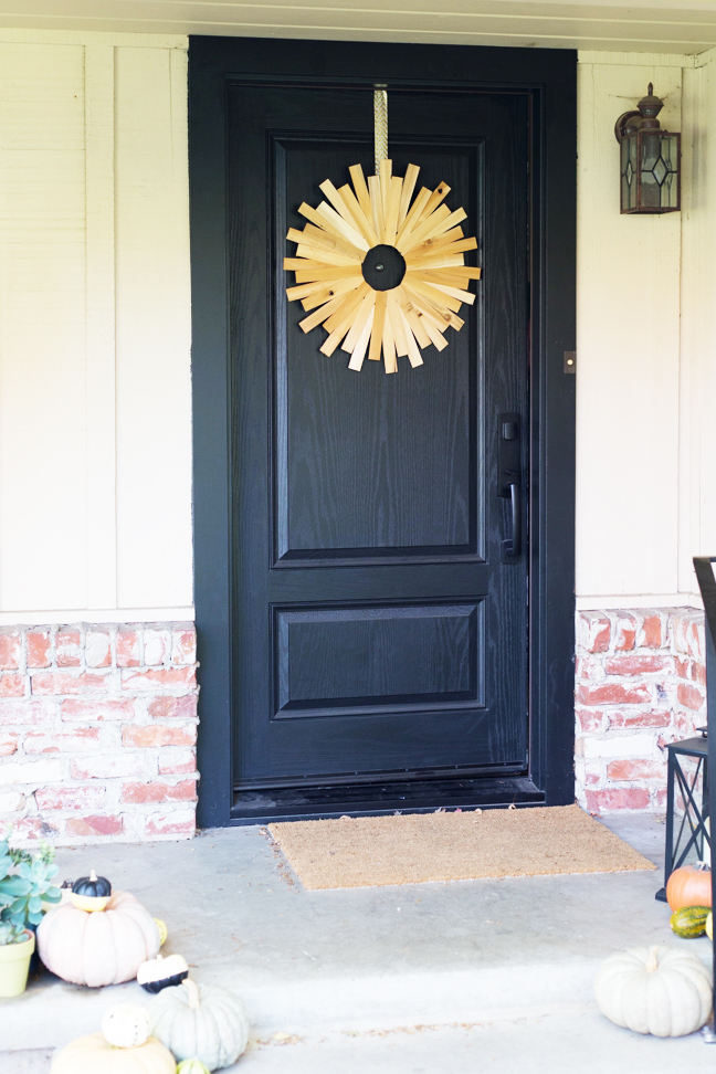 wood-starburst-wreath-on-black-door