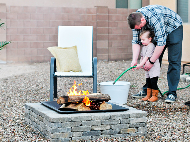 fire pit toddler water hose dad
