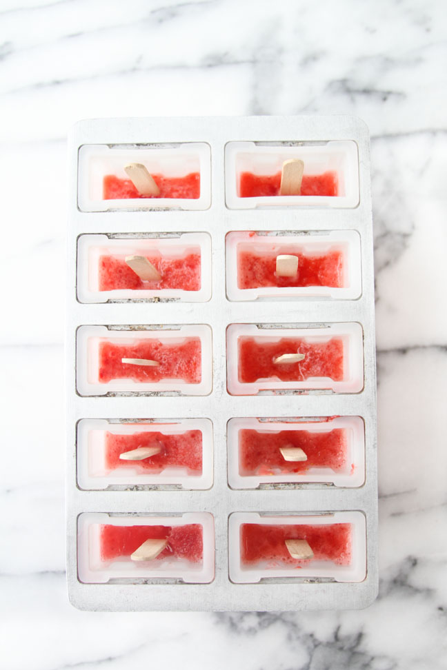 Freeze strawberry mixture for popsicles