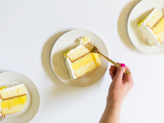 hand-with-fork-eating-pineapple-ice-cream-cake