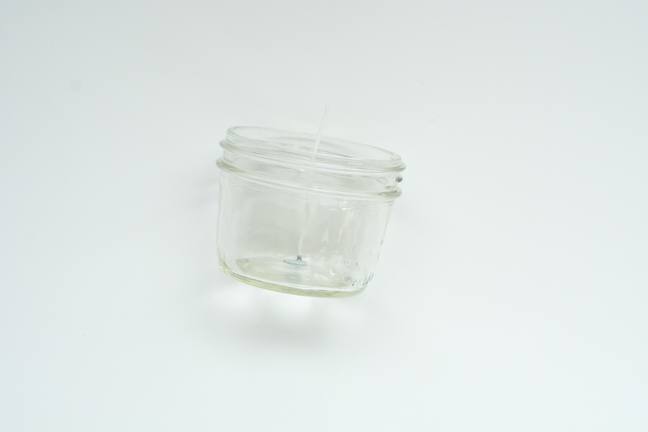 small mason jar with wick