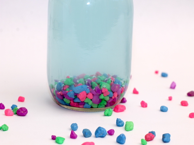 mason jar filled with colorful rocks