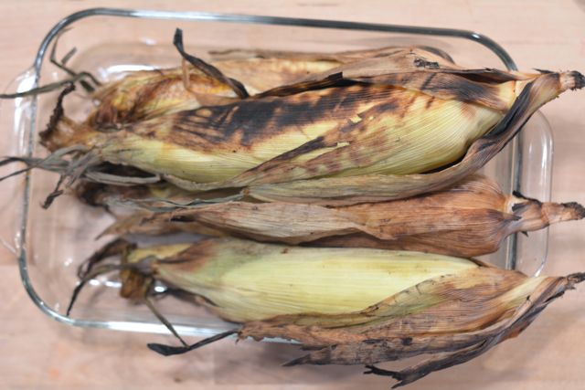 Finished grilled corn in their husks