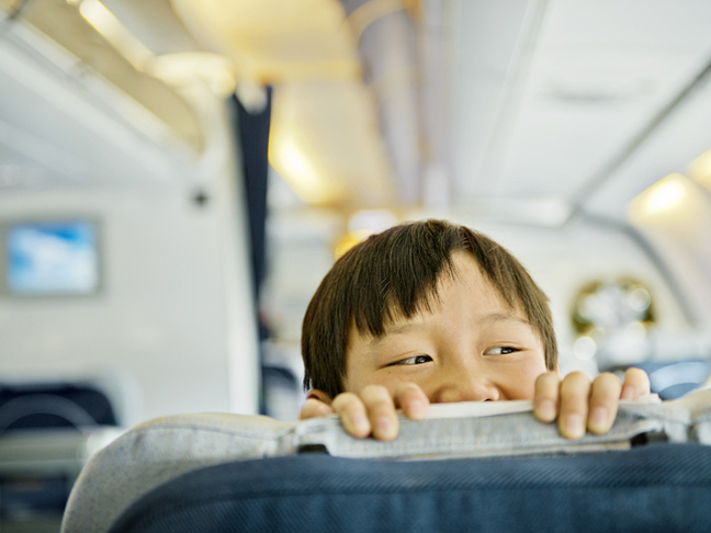 child-international-flight-plane-asian-seat