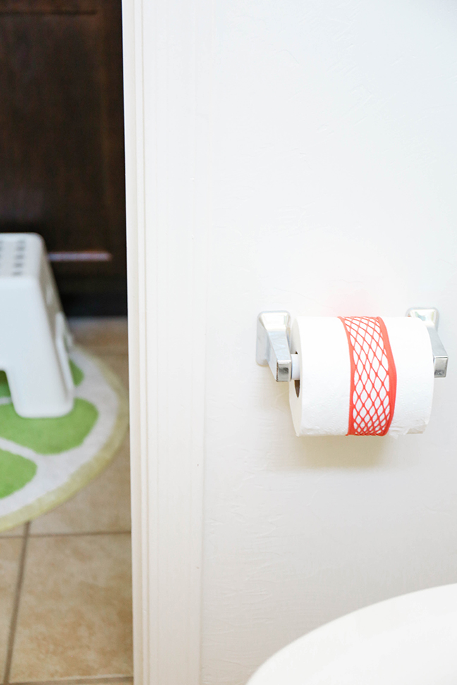 Keep bathrooms clean and tidy by placing a headband around the toilet paper roll \\ Toddler Proofing Tricks You've Never Heard of Before
