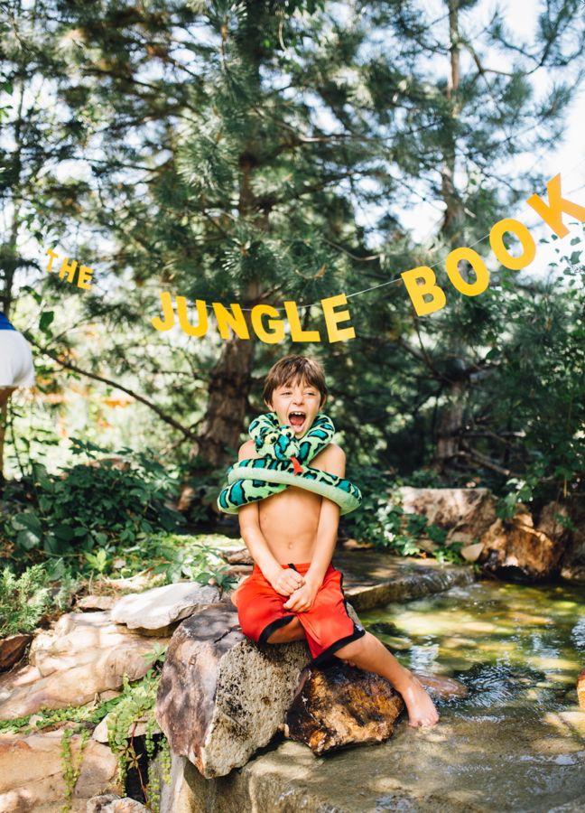 the-jungle-book-boy-wrapped-in-a-snake-outdoors