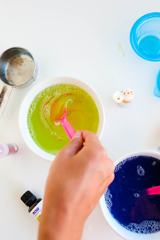 stirring pink glitter into yellow liquid