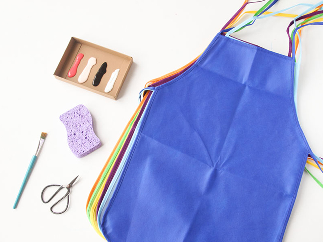 Materials needed for DIY artist apron for kids